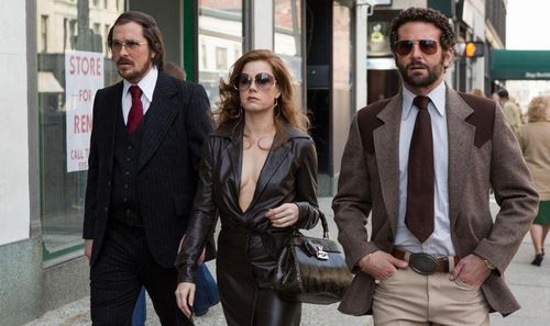 AMERICAN HUSTLE Christian bale Amy Adams Bradley Cooper